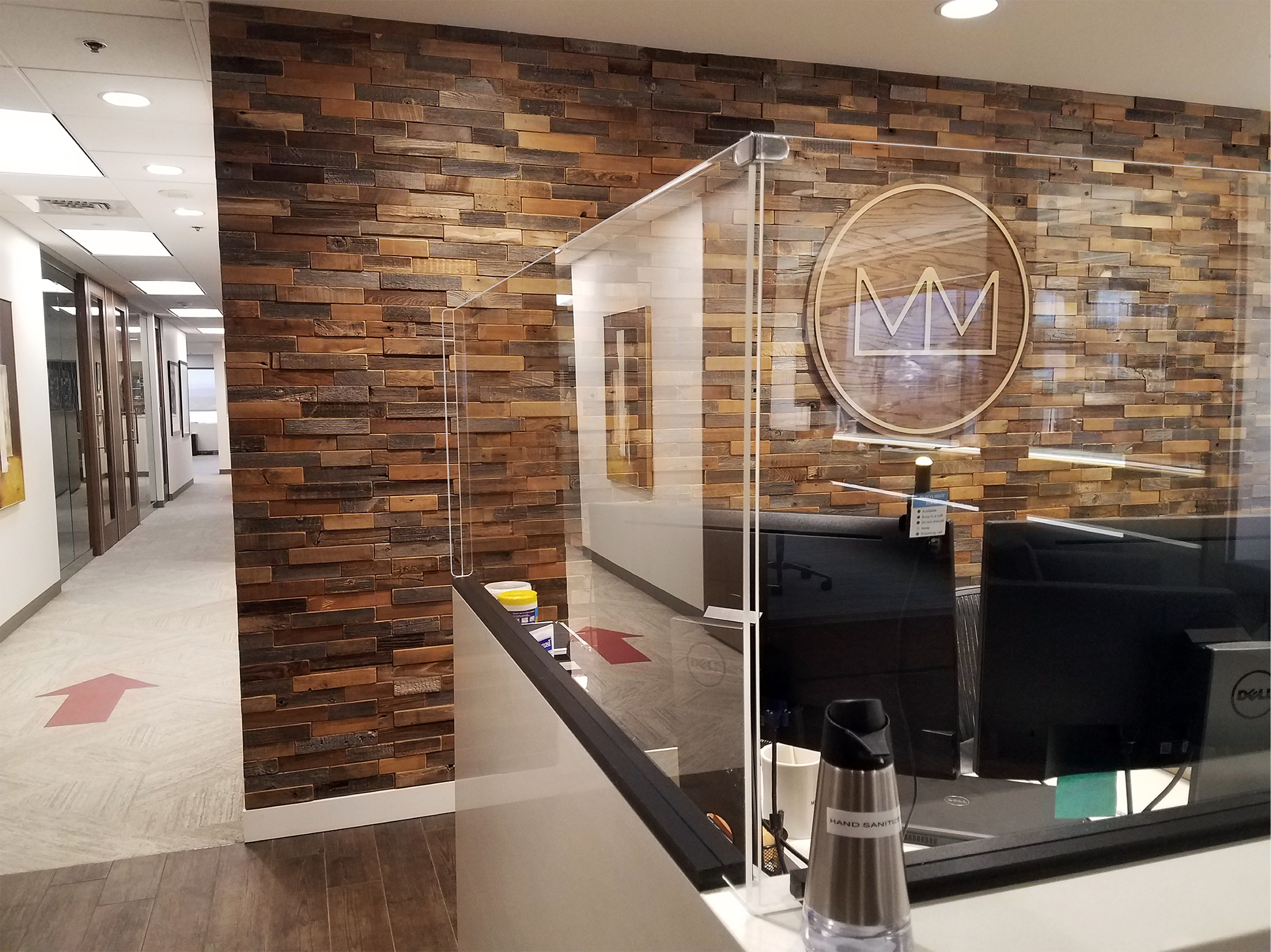 Barriers installed at the front desk of Melvin Mark in downtown Portland office